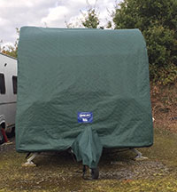 a caravan with its cover on for winter